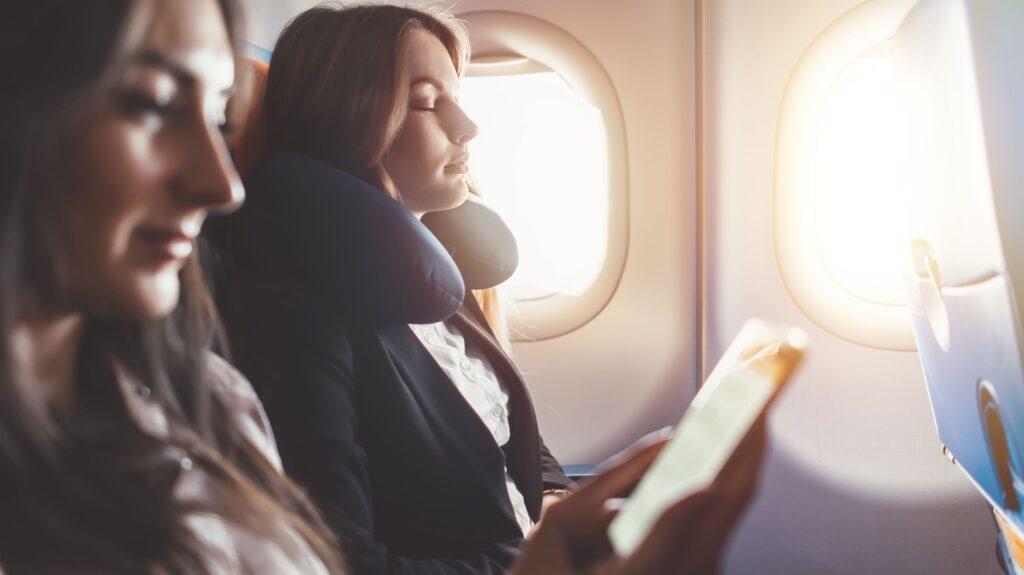 Business traveler relaxing on a flight.