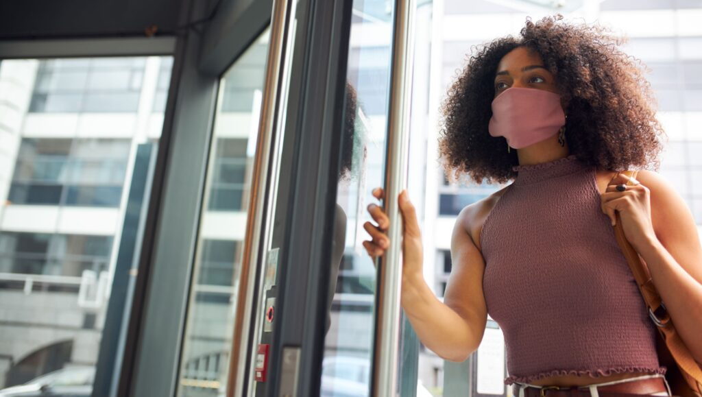 Women staff member walking through a door.